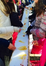 Roll a maple syrup taffy around a popsicle stick