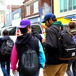 2 teen boys talking during Kensington market tour on Youth Exchanges Canada exchange. Photo by Sarah Cowan.